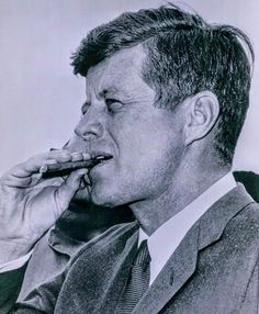 John F. Kennedy's favorite cigar was the H. The night before the embargo on Cuba was signed, he sent his aide Pierre Salinger to purchase every box he could gather from DC tobacconists for a total of cigars. John F Kennedy, Los Kennedy, Famous Cigars, Presidents In Order, Cigar Art, Cigar Club, Abercrombie Men, John Fitzgerald, Good Cigars