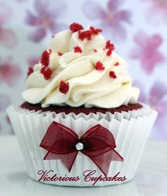 Red velvet cupcakes. Love the bow on the liner!