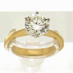Solitair ring 1.72ct. 18K geelgouden solitair ring gezet met een briljant geslepen diamant van 1.72ct, kleur J & helderheid P1. Diamant is gezet in een 6-poots draadchaton. #ring #rings | ringen | gouden ring | golden rings | golden rings design | vintage rings | trouw ring | trouw ringen goud | verlovingsring goud | sieraden amsterdam | #spiegelgrachtjuweliers SpiegelgrachtJuweliers.com Vintage Gold Rings, Vintage Jewelry, Luxury Watches, Rose Gold, Jewels, Engagement Rings, Collection, Antiques, Amsterdam