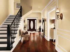 This long hallway's walls are covered in Behr's Ancient Scroll, highlighting the space's radiant natural light.