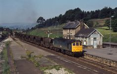 25113 (?) passes Chinley with a rake of empty ICI Hoppers.