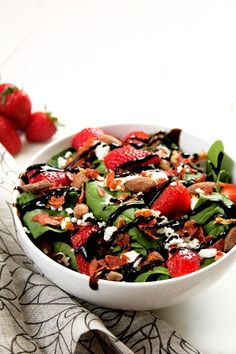 A simple salad with complex flavors of goat cheese, strawberries and prosciutto then tossed in a sweet balsamic vinaigrette!