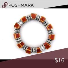 "Designer rust orange ceramic bead stretch bracelet Burnt orange 3/8"" ceramic beads and sparkling clear crystal rondelles with intricate silvertone findings form this pretty designer-style stretch bracelet. Jewelry Bracelets"