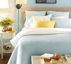 Colors, bedding, & headboard identical to ours! Want those reading sconces. :) Consider painting nightstands white.
