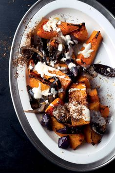 Roasted Butternut Squash and Red Onion with Tahini and Za'atar by Yotam Ottolenghi and Sami Tamimi, bonappetit #Butternut_Squash #Onion #Tahini