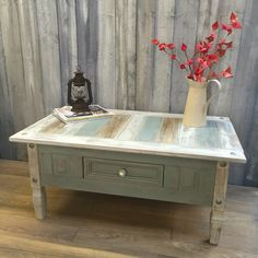 A solid piece of Mexican Pine Corona furniture, painted in beautiful ASCP Duck Egg Blue and Old White, heavily distressed and sealed with clear wax. I've perked up the black detailing pins with pewter Rub 'n' Buff, which ties in with the room, and added a blingy drawer pull for a bit of glamour.