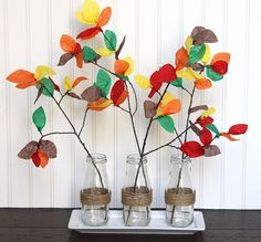 With these pretty Crafted Branches for Fall you can get your kids to help you decorate the Thanksgiving table! Make 'em work for their turkey. Thanksgiving Banner, Thanksgiving Crafts For Kids, Thanksgiving Decorations, Fall Crafts, Decor Crafts, Kids Crafts, Home Decor, Pumpkin Vase, Pumpkin Flower