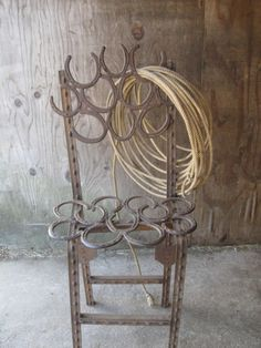 One of several T post and horseshoe chairs that I made about 4 years ago out of really old T posts and used saddle horse and mule shoes. They are surprisingly comfortable and they line the aisle way of our stable.