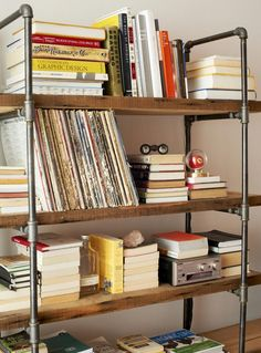 This industrial-style shelving unit was built from reclaimed wood and pipes. It's an easy and inexpensive bookcase solution.