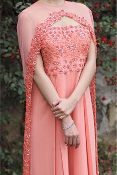 The Stylish And Elegant Gown In Peach Colour Looks Stunning And Gorgeous With Trendy And Fashionable Fabric Looks Extremely Attractive And Can Add Charm To Any Occasion. Shrug For Dresses, Indian Gowns Dresses, Indian Fashion Dresses, Indian Designer Outfits, Pakistani Dresses, Indian Outfits, Designer Dresses, Pakistani Suits, Pakistani Bridal