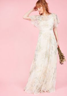 <p>The ethereal aesthetic of this ivory gown by Jenny Yoo was designed to make you feel simply adrift! A V-back slip sets the foundation for this awe-inspiring dress so that its watercolor overlay - comprised of flutter sleeves, a drawstring waist, and a neutral-toned flowers - may inspire visions of romance and reverie.</p>