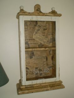 Clock case repurposed into a bathroom cabinet and decoupaged with 1946 newspaper