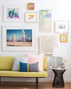 Colourful yellow couch and gallery wall