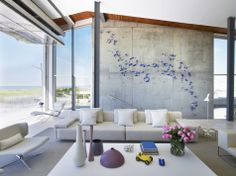 Concrete wall breezy room and small purple butterflies