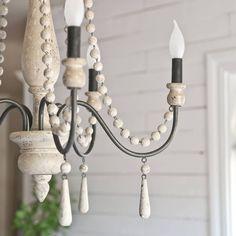 Rustic farmhouse chandelier in the dining room |  @katienisbett on Instagram