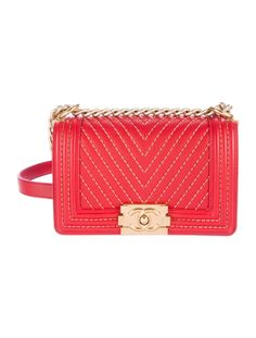 From the 2017 Collection. Crimson chevron quilted leather Chanel Small Boy bag with antiqued gold-tone hardware, single shoulder strap with chain-link and leather accents, chain-link stitching at exterior, beige grosgrain lining, single slit pocket at interior wall and CC push-lock closure at front face. Serial number reads 23376547. Shop authentic designer handbags by Chanel at The RealReal.