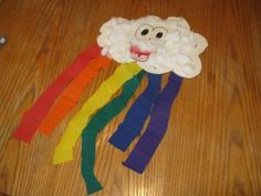 Crepe paper and cotton ball cloud with rainbow