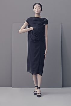 It is not easy to trace the origin of the structured minimalist collection called LESS, perfectly set in scene by Shanghai-based French photographer Matthieu Belin. The designer Liao Dan seems to have limited herself to just this single, splendid collection. And so we don't want to keep this discovery to ourselves, although it is a Spring/Summer 2014 collection.