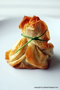 Phyllo pastry purse with salmon and spinach pesto