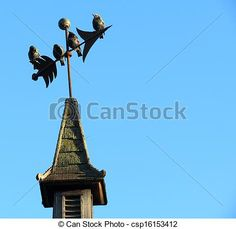 4 birds sitting atop a weathervane against a blue, summer sky.
