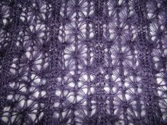 This post introduces an original pattern for a beautiful scarf made in double-bed tuck stitch on a standard gauge machine. The yarn is a silk-mohair blend with a beautiful halo. The resulting sca…