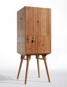 China's Guangzhou based architecture and design studio utopia has created a functional cabinet that draws from the principles of the fibonacci sequence(the numbers in the following integer sequence:0,1, 1, 2, 3, 5, 8, 13, 21, 34, 55,89,144...)