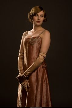 Lady Edith, Downton Abbey Christmas Special.  Beautiful dress - the colour suits her.
