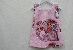 Reversible pinafore dress.