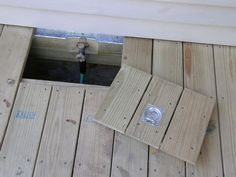 Build a trap door in your deck floor to access hidden garden hose spigot. Or in my case it would be to access the hot tub pump.