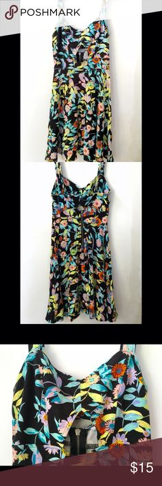 PacSun Volcom Floral Dress Black and colorful floral short dress that's perfect alone on a hot day or paired with a cute sweater or cardigan! Hugs the waist with a flowing skirt. Cutout in front (sternum area) and back (with snap closure). Runs slightly small. Volcom Dresses Mini