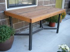 Oak & welded steel table. Love the struts on the bottom. very functional looking table with simple lines. looks kid-friendly. $780