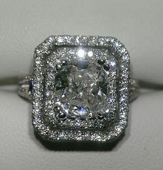 2 carat cushion cut with 1 carat of sidestones set in 18k white gold.