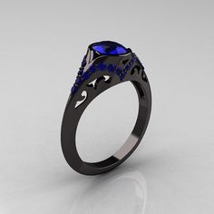 Classic 14K Black Gold Oval Blue Sapphire Wedding Ring, Engagement Ring R194-14KBGNBS. $2,149.00, via Etsy.