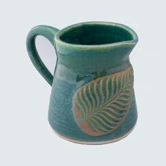 Stoneware pottery creamer, green glaze, with leaf stamp appliqué (12 oz) - pinned by pin4etsy.com