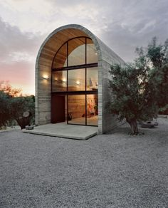 Art warehouse in Boeotia by Greek A31 Architects is situated amongst olive, oleander and cypress trees, on a 4000 m2 plot just few meters away from painter and sculptor Alexandros Liapis.