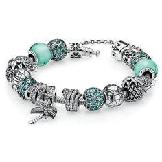 PANDORA Caribbean Cool Charm Bracelet -  	I can practically feel the cool ocean breeze and the warm sand on my feet! 	 	The PANDORA Caribbean Cool Charm bracelet features green, teal & blue sparkling charms with CZs paired with all of your favorite tropical-themed charms! Get ready to catch a wave with this adorable bracelet!
