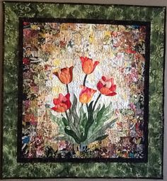 """Tantalizing Tulips""  water color quilt wall hanging.   Completed and free motion quilted in 2012 for the Las Vegas Quilter's Guild challenge by Meriul Easton."