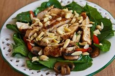 Asian Spinach Salad with Chicken, Mushrooms, Peppers, and Almonds  2 boneless, skinless chicken breasts  1 cup sliced sweet mini-peppers or red pepper strips (red, yellow, or orange)  4-6 oz. sliced mushrooms, sauteed  >1/4 cup slivered almonds  2-3 green onions, sliced  4 handfuls baby spinach (I buy prewashed spinach, wash if needed)