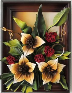Handmade Leather Carnations and Lillies Flowers.Handmade Leather Carnations and Lillie's Flowers  Size: 40cm x 30cm  Frame: Solid Wood, Brown Stained Oak  Colors: Cream, Walnut, Green, Red, Brown, White  Material: Genuine Leather