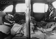 The Nazi Propaganda on the back of the image reads: Small images of a huge trip. This is the highest comfort: Tilting back the car seats, one creates a nice bedroom. Image from the Eastern Front, 4 August 1942.
