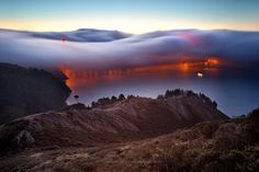 Another stunning shot by Andrew Louie, of fog just covering the Golden Gate bridge.