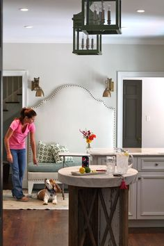 lounge area in the kitchen - love the nailhead banquet and all light fixtures in this pix