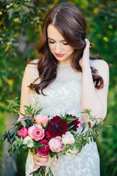 With the fall season's lower temperatures, you won't have to worry about sweat messing up your bridal hairstyle. It's a great time to opt for soft romantic waves. {Kate Osborne Photography}