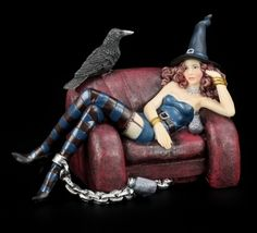 Witch with raven sitting on couch by Andy Jones.