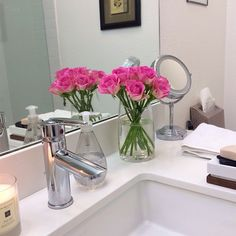 Loving today's fresh blooms for the guest bathroom from Trader Joes.  Beautiful baby roses. I pruned all the leaves, and love how clean and vibrant it looks. #freshblooms #obsessedwithflowers