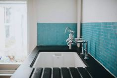 Solid-surface materials like Corian can be used for sinks and countertops. Check out these styles and decide if a Corian sink is right for your home. Bathroom Sink Taps, Bathroom Vanities Without Tops, Bathroom Vanity Units, Small Bathroom, Sinks, Faucets, Corian Sink, Kitchen Trends, Kitchen Ideas