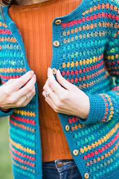 Jessica Cardigan Crochet pattern by Catherine Waterfield Vintage-styled granny stitch cardiganThe sample was made with Kauni Unicolor in Peacock, and Noro Kureyon Sock in Rainbow. Suggested substitute yarns are shown below. Crochet Cardigan Pattern, Granny Square Crochet Pattern, Crochet Jacket, Crochet Squares, Crochet Granny, Knit Crochet, Crochet Patterns, Crochet Fall, Crochet Christmas