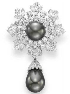A DIAMOND AND CULTURED PEARL BROOCH, BY BULGARI   Suspending a detachable drop-shaped gray cultured pearl, decorated with a marquise and circular-cut diamond cap, from a circular and marquise-cut diamond foliate plaque, centering upon a gray cultured pearl, mounted in platinum  Signed Bulgari