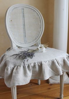 The Isabella Ruffled Linen chair slipcover with ballerina ties in natural linen. $55.00, via Etsy.