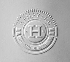 Blind Embossed logo for Henry + Company.